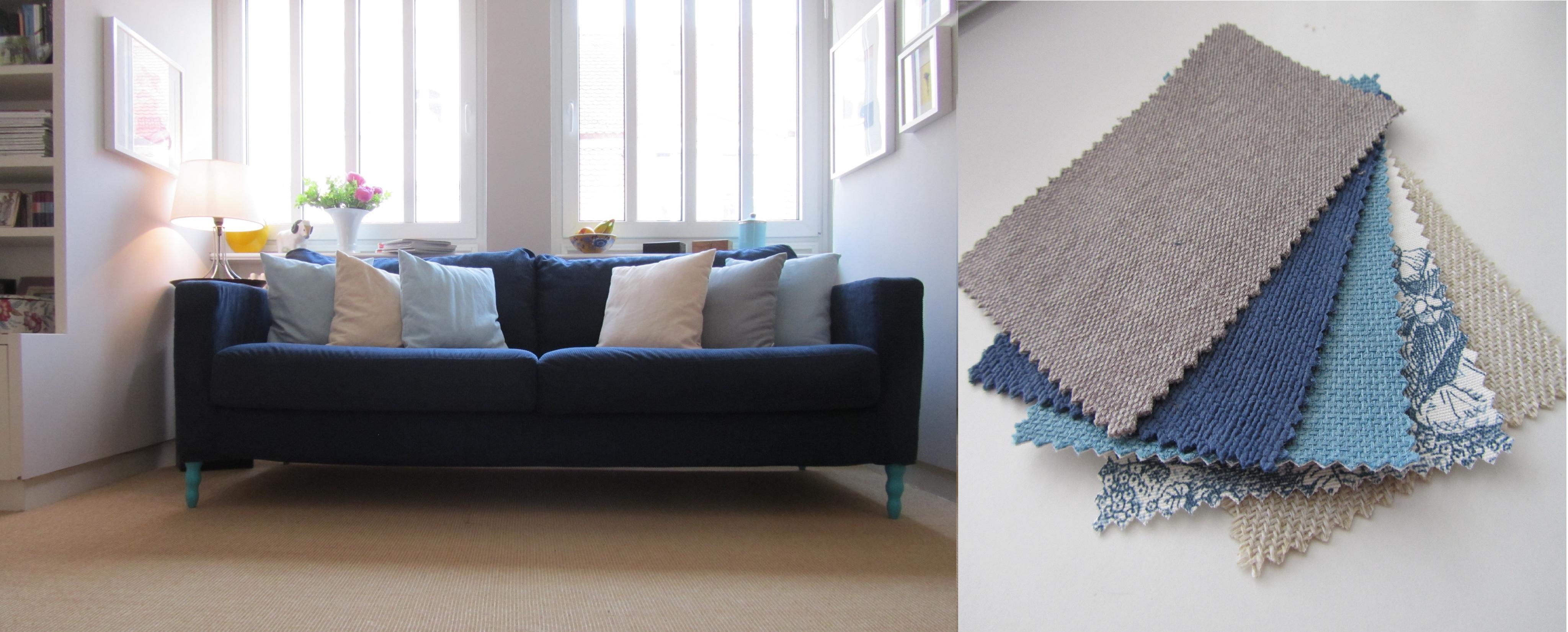 das wohnzimmer mit den blaut nen sessel kissen vo. Black Bedroom Furniture Sets. Home Design Ideas