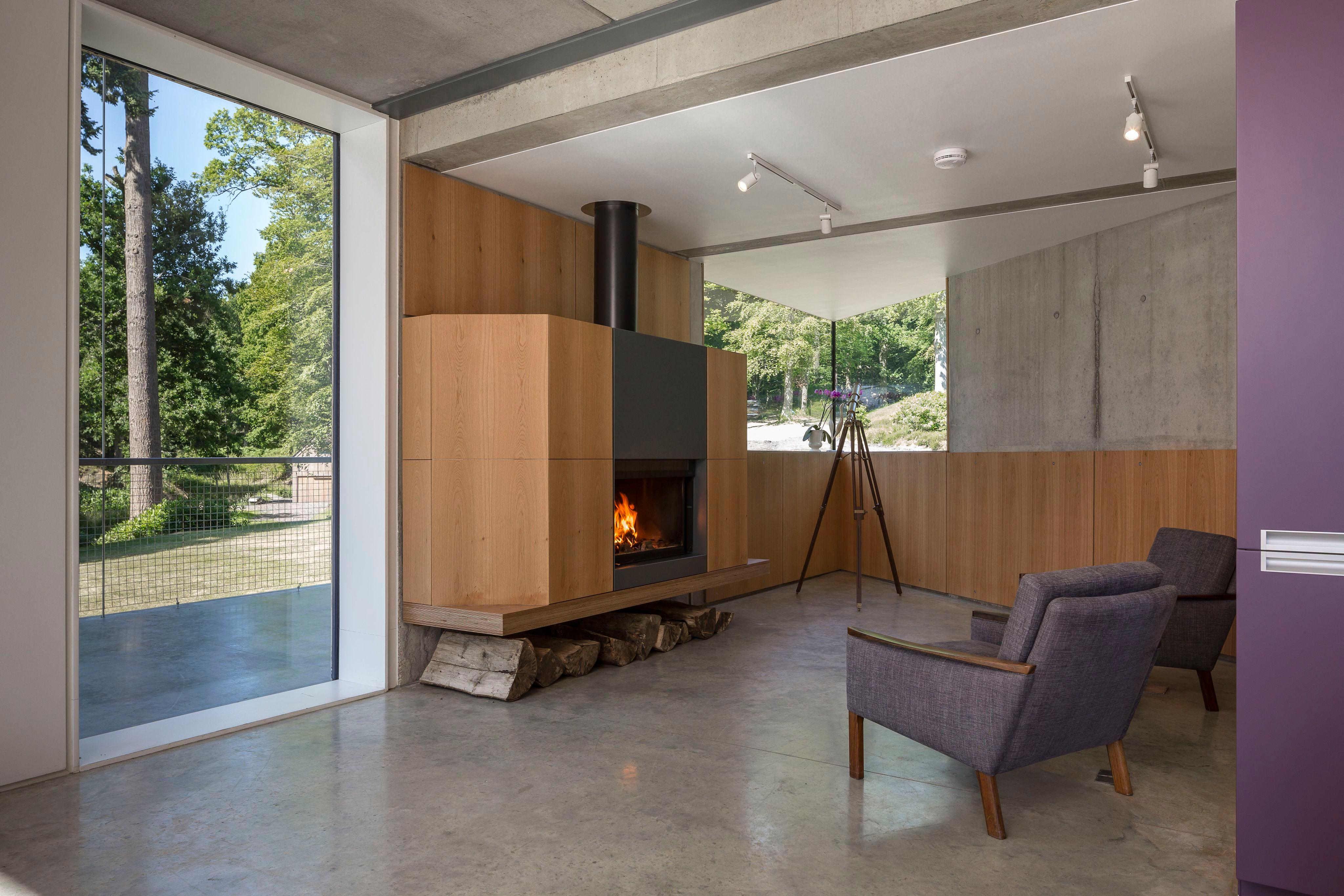 moderne kaminecke kamin sessel groesfenster manser medaltim crocker architekt - Bcherregal Ideen Neben Kamin