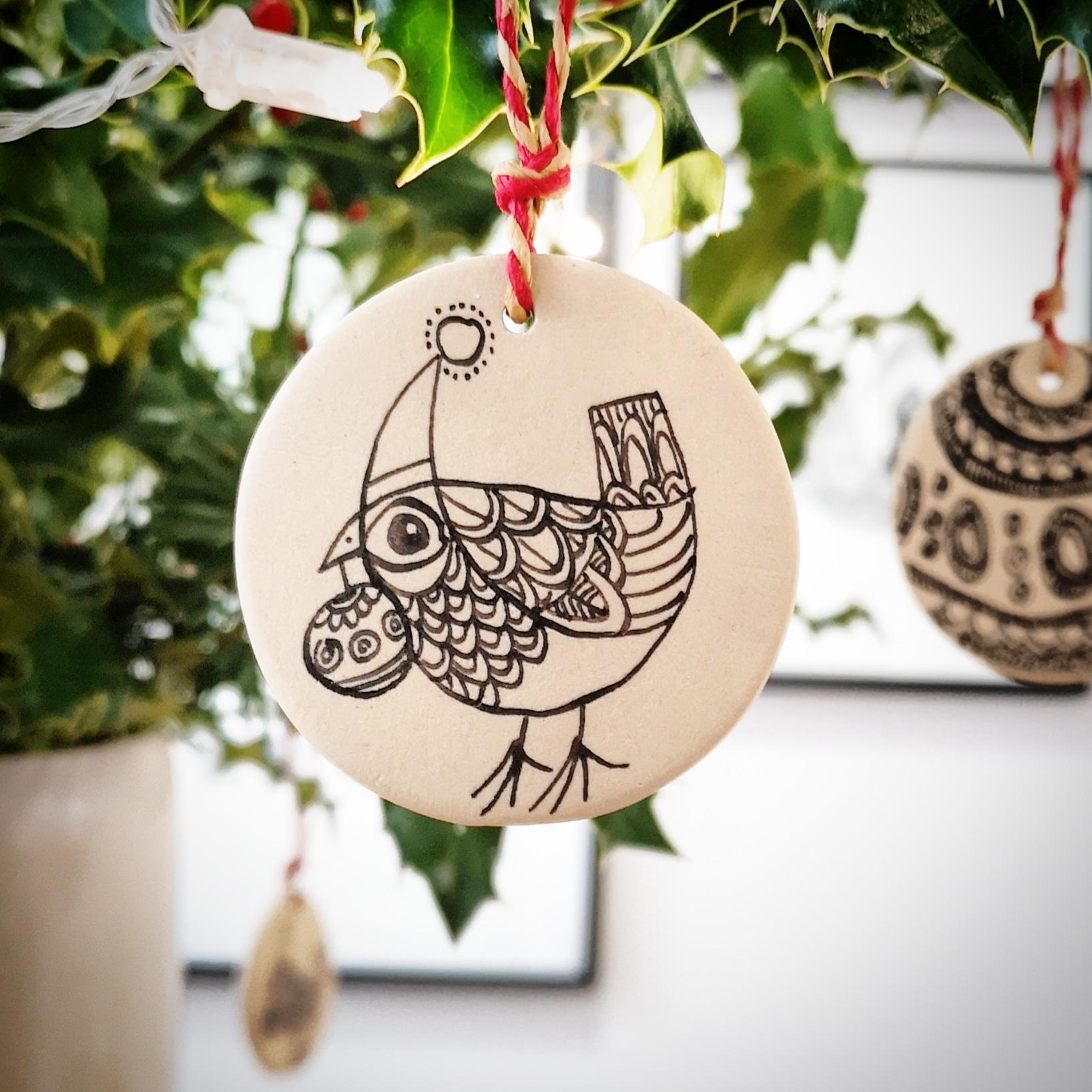 Stoneware ornaments hand-decorated be me. Fun to make.