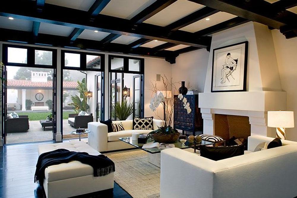 Wohnzimmer Fensterfront Couchtisch Kamin Dachbalken Sofa Glascouchtisch